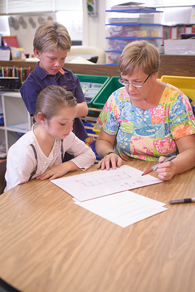 Cathe Runyan helps students with Math in Grouse Creek, UT